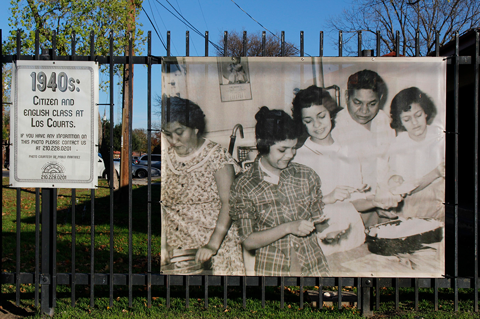 To promote Alazán-Apache's history, Sánchez's organization has tied black-and-white photographs of former residents to fences around the complex.