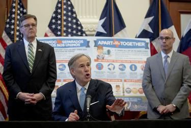 Gov. Greg Abbott, flanked by Lt. Gov. Dan Patrick, left, and House Speaker Dennis Bonnen, speaks during a press conference at the state Capitol over the state's response to the coronavirus on March 31, 2020.