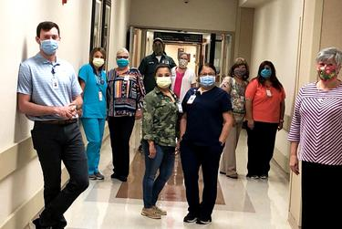 Donna Boatright, right, joins her cousin Kaleb Hoover, left, and other pairs of relatives who work at the Rolling Plains Memorial Hospital.