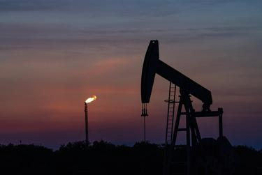A pump jack and a gas flare in the Eagle Ford oil patch south of San Antonio.
