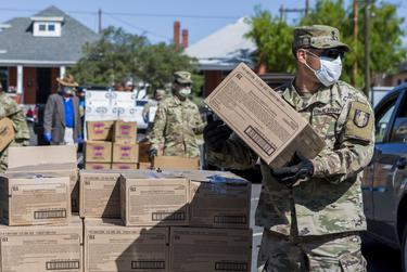Members of the National Guard hand out food at the Kelly Memorial Food Pantry in Central El Paso during the Coronavirus pandemic on Tuesday.