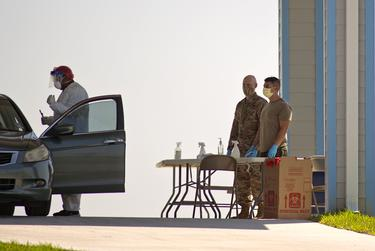 National Guard personnel manage a mobile coronavirus testing site in Fulton, north of Corpus Christi.