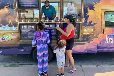 Belinda Norman and her sons Maxwell, 9, and Joseph, 3, go out for shaved ice in Midland.
