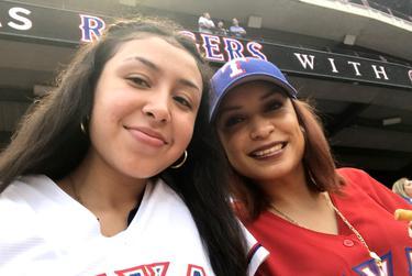 Samantha Salas (left) and her sister Liz at a Texas Rangers baseball game.