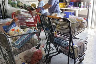 """It's been at least a month and a half since Liz Salas last saw a woman who regularly visited her food pantry. """"Hopefully, God permitting, we cross paths again and I can see if she's OK,"""" Salas says."""