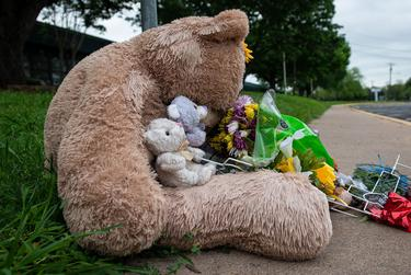 A memorial sits outside of G.W. Carver Middle School for Principal Phillip Perry, 49, who died on March 31 from coronavirus.