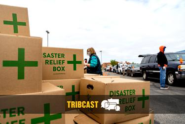 At the Waco ISD Stadium, volunteers from the Central Texas Food Bank load boxes of food into cars. Thousands of people waited in line to receive food.