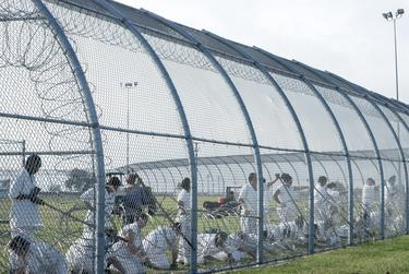 Prisoners work outdoors at the Dr. Lane Murray Unit, a women's prison that's part of the Texas Department of Criminal Justice.