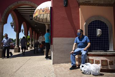 Customers visit La Gran Plaza in Fort Worth on the first day that  shopping malls, restaurants, retail outlets and movie theaters were reopened on May 1, 2020.